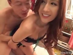 Her big Japanese tits are enjoyed by two guys that fuck her