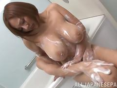 Busty Asian chick with a hot ass getting her wet pussy fingered