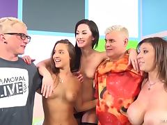 Dark-haired porn star with small tits enjoying a hardcore foursome