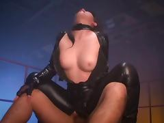 Submissive in a shiny leather catsuit used by multiple guys