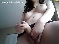 Hot shemale with big tits shows off her body
