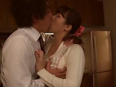 Japanese MILF orally services a guy in the kitchen