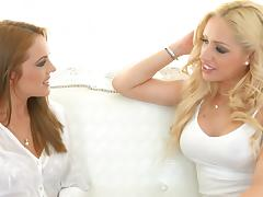 Lesbian blondes have a finger banging good time in bed