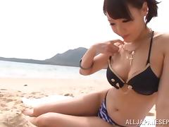 Eye catching Japanese beauty strips at the beach and jerks off a thick cock