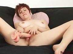 Natural readhead shoves a plastic dick up her wet hairy cunt