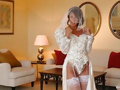 Breathtaking bride dressed in white strips and teases her tits