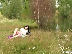 Teen beauty in the grass is alone and free to masturbate