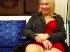 MILF with nice thighs showing herself in train