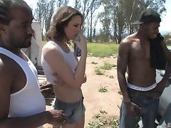 Brunette vixen gets double teamed by two black studs outdoors