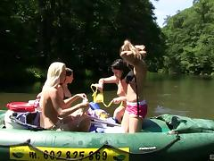 While rafting down a river three girls get naked and eat pussy