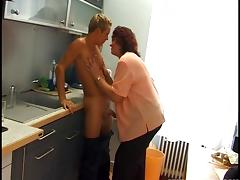 A busty mature lady seducing a sales person to have sex with her inside the kitchen