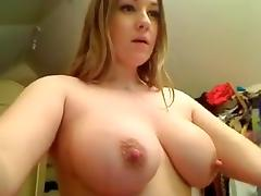 Big titted hottie teases on adult cam