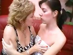 Mature and youthful brunette licking and fingering