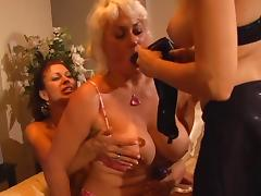 Mature slut plays with tits while friend sucks hard dildo
