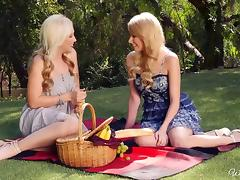 Glamorous blonde lesbians making sweet love outdoors