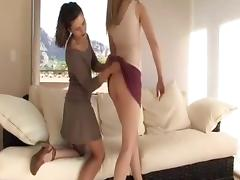 Young girls use a dildo in their pussies.