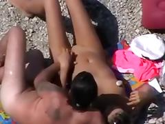 Unsuspecting pair receive filmed fucking on the beach