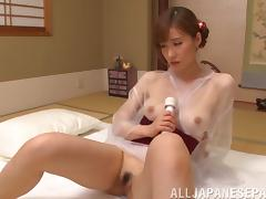 Alluring mature Japanese woman gives a blowjob and rides a man's cock