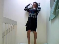 Amateur crossdresser solo on a floor