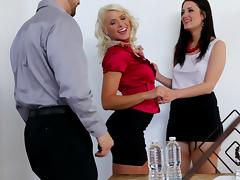 A wife works up a sweat while fucking in a threesome