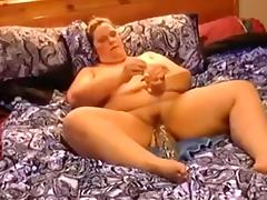 Amateur SSBBW wife in bed using a huge sex tool for her cunt