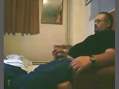 Dude smokes a cig, while his bbw wife sucks and rides him on the sofa.