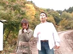 Outdoors with a hairy pussy Japanese girl taking his dick