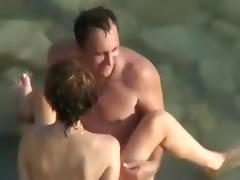 Voyeur tapes a nudist couple having sex in the sea