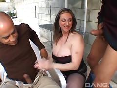 Huge tits slut in a corset has sex with two big dick men