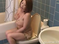 Mature nasty  Asian chic masturbates in a solo shoot