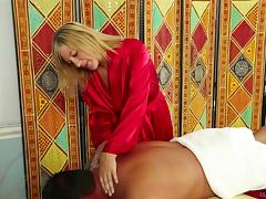 Curvy masseuse makes him hard and sucks him off lustily