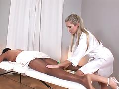 Black dude on the massage table fucks the gorgeous blonde