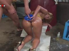 She fucks a huge dildo and penis with oiled up body