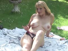 Curvaceous blonde with lots of experience masturbates on the grass