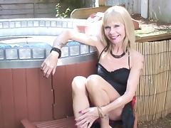 Naughty experienced blonde stabs her own pussy by the pool
