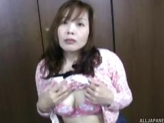 Asian MILF with a big bush gets on top and grinds her pussy