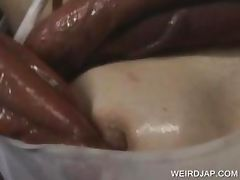 Sexy asian slave wrapped in tentacles