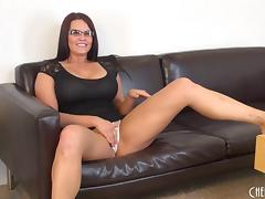 Hot chick in glasses with big tits playing on her cam