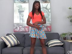 Chocolate beauty pushes the glass dildo deep into her dark pussy