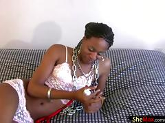 Bashful ebony TS in pink lingerie fucks her anal with dildo