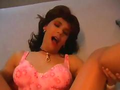 Tranny In Lingerie Stretched On A Bed