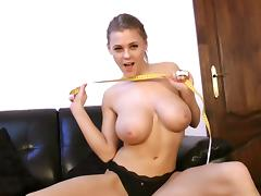 Sweet girl measures her big natural tits for you