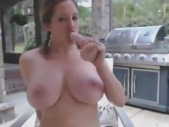 Squirty Busty Cowgirl Masturbates In Courtyard