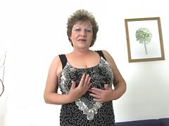 Golden dildo makes the big tits granny feel good