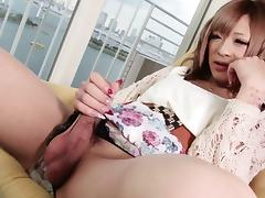 Petite Asian shemale spreads her ass while pumping her cock