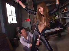Kinky Asian in a leather catsuit sucks dick erotically