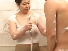 Chubby Japanese girl sucks her partner's schlong in the bathroom
