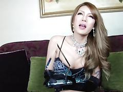 Asian glamour tranny spreads her ass cheeks and fucks a toy