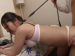 Leashed Japanese sub girl spit roasted in a hotel room