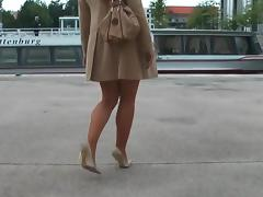 Classy lady strolling through berlin in high heel stilettos